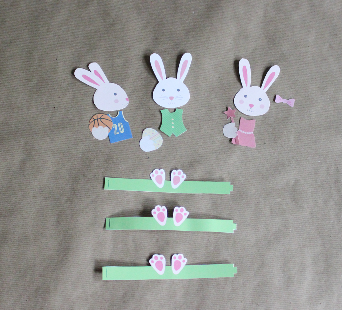 Print the PDF with the bunny heads and paw bases on a thicker cardstock.  Print the other PDF, with the clothing and accessories, on sticker/label  paper.