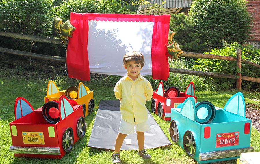 Easton's Retro Outdoor Drive-In Movie 3rd Birthday Bash, drive-in movie party, drive-in party, outdoor movie party, outdoor movie birthday party, car party, kids birthday party, Just Add Confetti, cardboard box cars, DIY cars, DIY cars for kids, concession stand, popcorn, outdoor movie, party blogger, Pittsburgh blogger, drive-in movie birthday party, backyard drive-in movie theater, transform your backyard into a drive-in movie theater